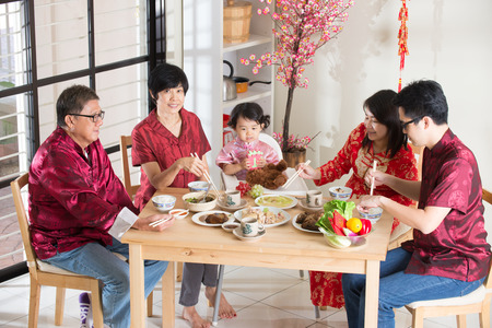 family dinner: Chinese new year reunion dinner, part of Chinese culture to gather during eve Stock Photo