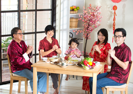 chinese new year food: chinese family giving greetings during chinese new year