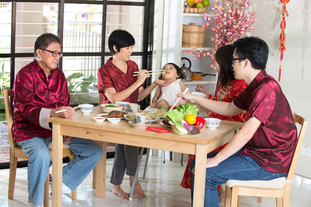 chinese meal: Chinese new year reunion dinner, part of Chinese culture to gather during eve Stock Photo