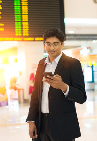 wireless terminals: indian male at airport terminal in the early morning