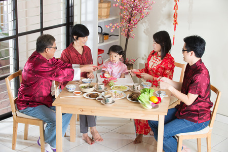 baby rice: Chinese new year reunion dinner, part of Chinese culture to gather during eve Stock Photo
