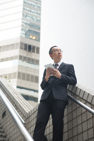 chinese businessman: chinese businessman with tablet computer on hong kong central district