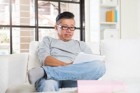 senior asian: asian senior using tablet