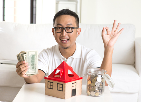 banknote: asian man happy with house loan Stock Photo