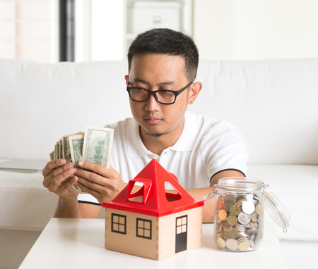 trouble: asian man having trouble with debts