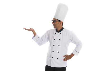 introducing: indian male chef introducing something Stock Photo