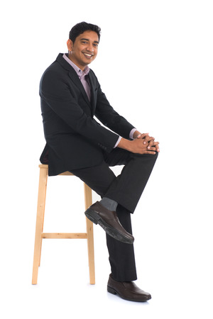 mid thirties: indian male sitting on chair