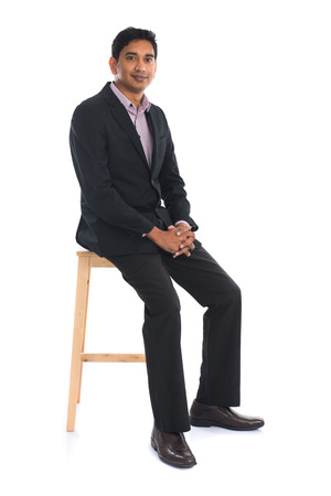 sit on studio: indian male sitting on chair