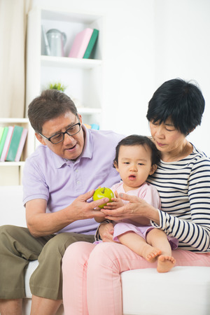 grand parents: asian grand parents with crying grand daugther Stock Photo