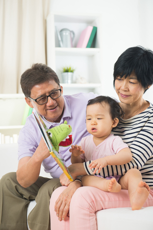 grand son: asian grand parents with crying grand daugther Stock Photo