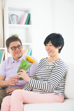 truelove: asian senior couple giving flower