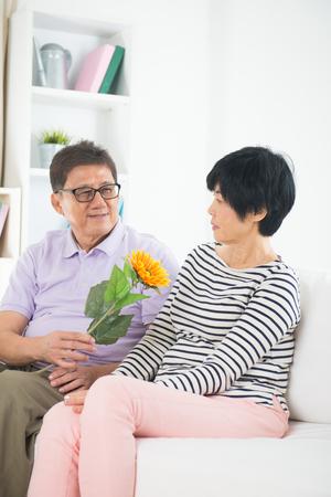 truelove: asian senior couple giving flower