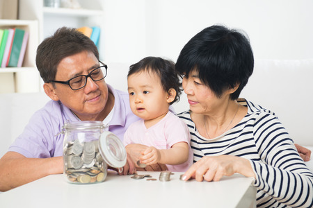 asian family home: Asian family saving money indoor, financial concept, grandparents and grandchild living lifestyle at home.