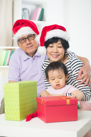 grand parents: asian grand parents with grand daugther celebrating christmas