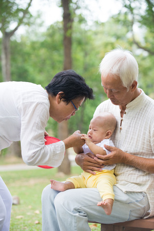 grandkid: asian grandfather playing with grandkid