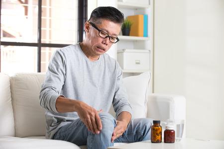 asian senior with knee pain medicine