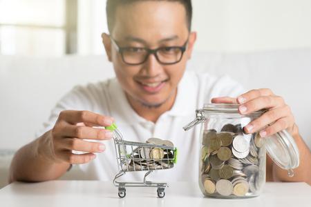 asian adult: asian male saving money Stock Photo