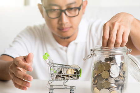 asian male saving money Imagens