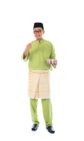 malay village: traditional malay male with raya cookie Stock Photo