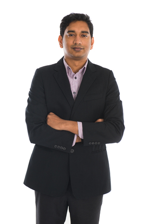 standing businessman: indian business male in coat