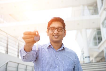 key handover: indian male with car keys