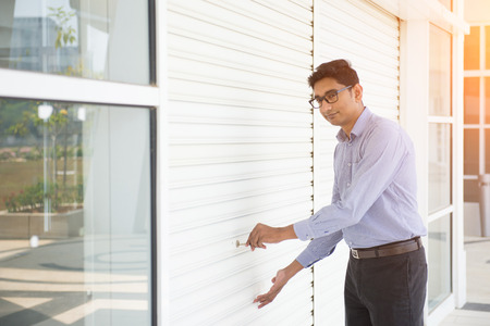 commercial building: indian business male checking properties