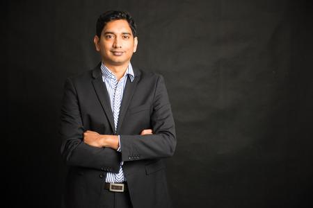 indian male businessman black background