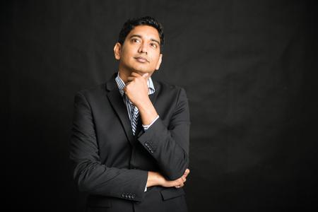 black businessman: indian male businessman black background