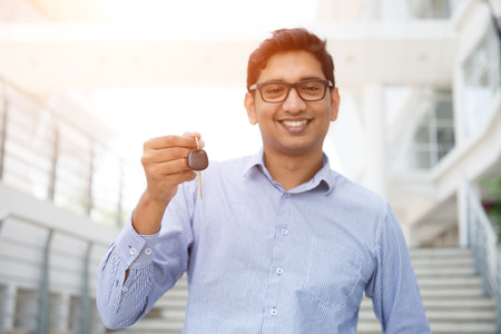 passing over: indian male with car keys