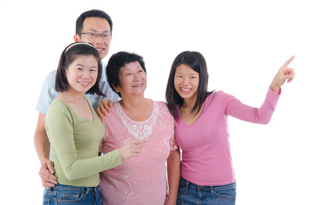 happy asian people: asian family pointing to somewhere