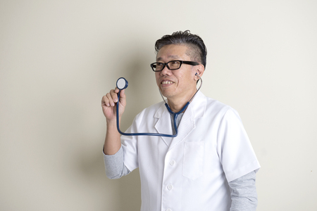 man looking: doctor with stethoscope Stock Photo