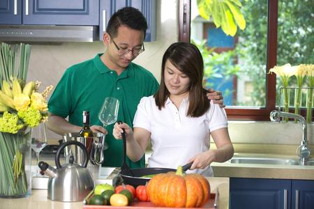 pan asian: asian couple cooking lifestyle photo