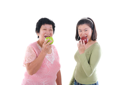 chatting: asian senior male having appl with her  daughter Stock Photo
