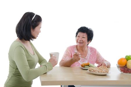 mom son: asian senior female dining