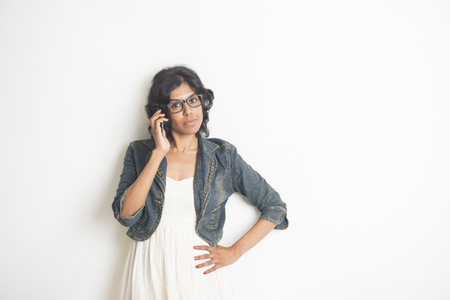 hispanic woman: businesswoman is happy and using her phone Stock Photo