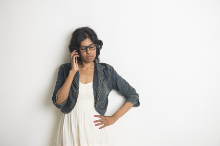 latin american ethnicity: businesswoman is happy and using her phone Stock Photo