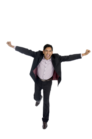office man: indian business male jumping in joy