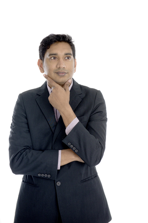 casual business man: indian business male thinking