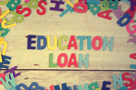 education loan: education loan word block concept photo on plank wood