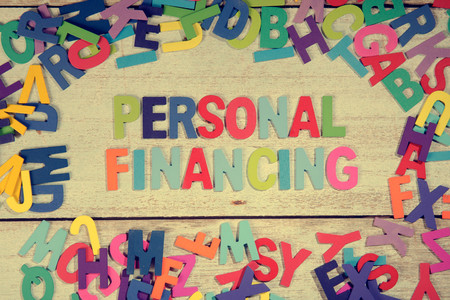 personal financing word block concept photo on plank wood