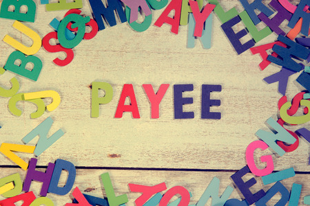payee: payee word block concept photo on plank wood