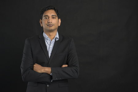 indian professional: indian business male with black background