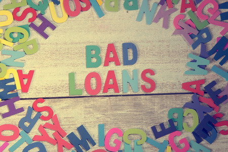 loans: bad loans word block concept photo on plank wood Stock Photo