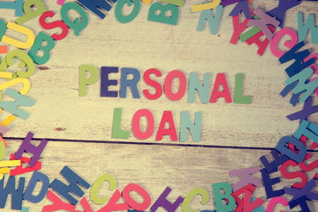 loan: personal loan word block concept photo on plank wood