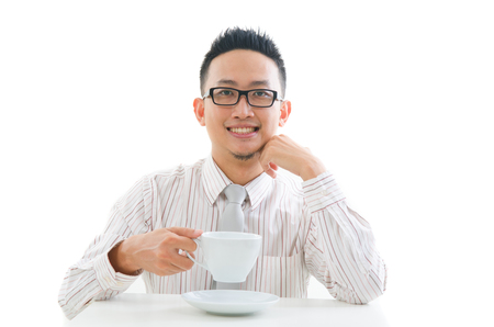 asian business male drinking coffee photo