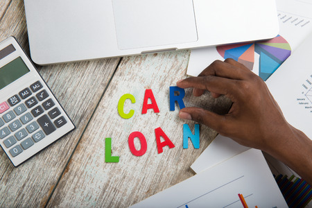 titles: hand arranging car loan concept photo Stock Photo