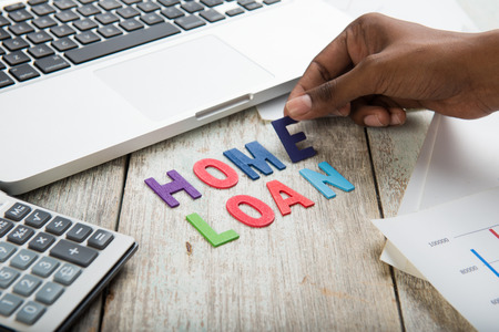 home loan: hand arranging home loan concept photo