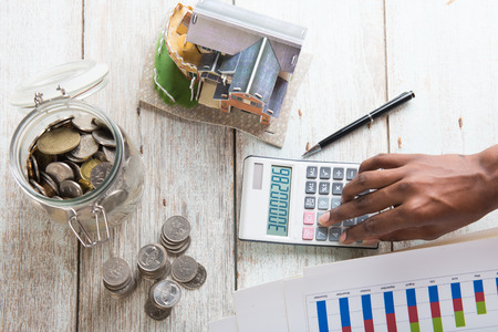 hands calculating home mortgage concept photo