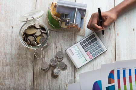 住宅ローンのコンセプト写真の計算手 写真素材