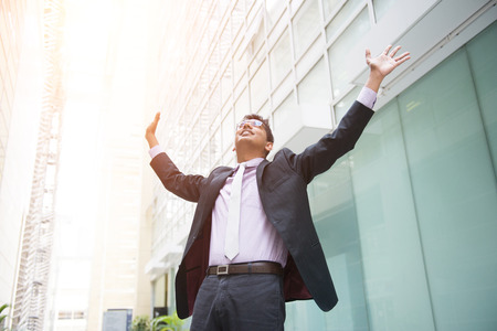 open hands: indian male business man celebrating success Stock Photo